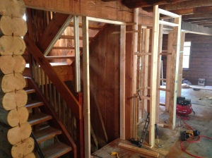 New framing for basement door and entry closet.