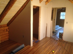 Walk in closet in master bedroom framed out and drywalled.