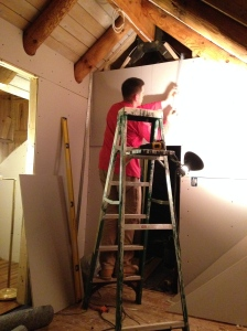 Tricky drywall in the upstairs.  There are no straight edges in log homes.