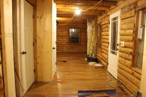 Front entry with new interior and exterior doors and floors.
